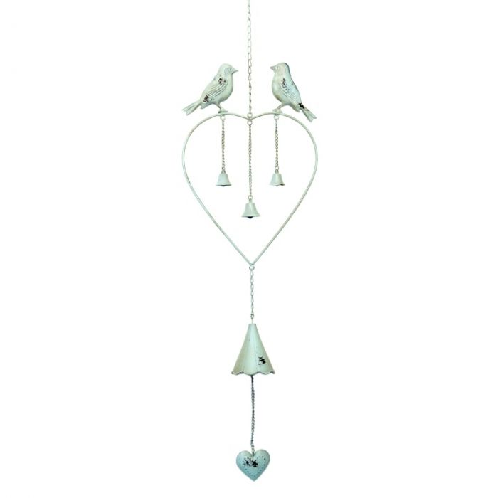 A heart shaped windchime with two perching birds and three small bells below, with one larger bell hanging from the base