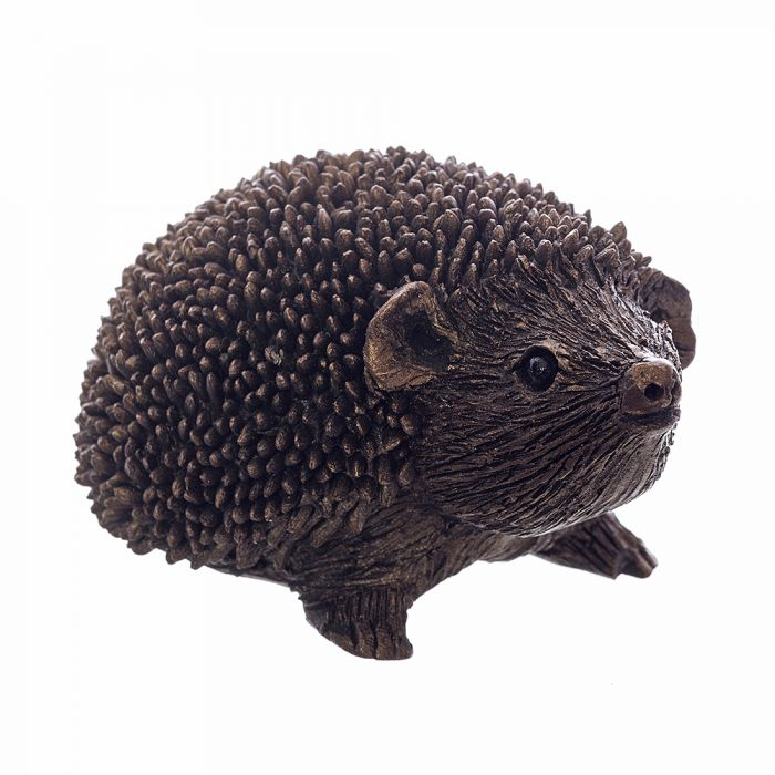 A small bronze finish resin hedgehog looking inquisitively out from the screen with an upturned face