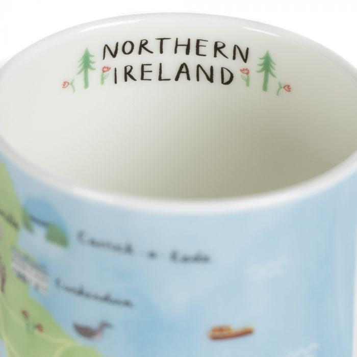 Inside the Northern Ireland mug which is painted with Northern Ireland and trees