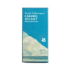 A bar of caramel sea salt chocolate wrapped in blue paper with an illustration of the sea