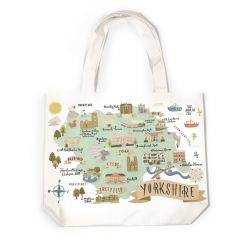 A Yorkshire National Trust canvas bag which has a map with images of the towns and National Trust properties